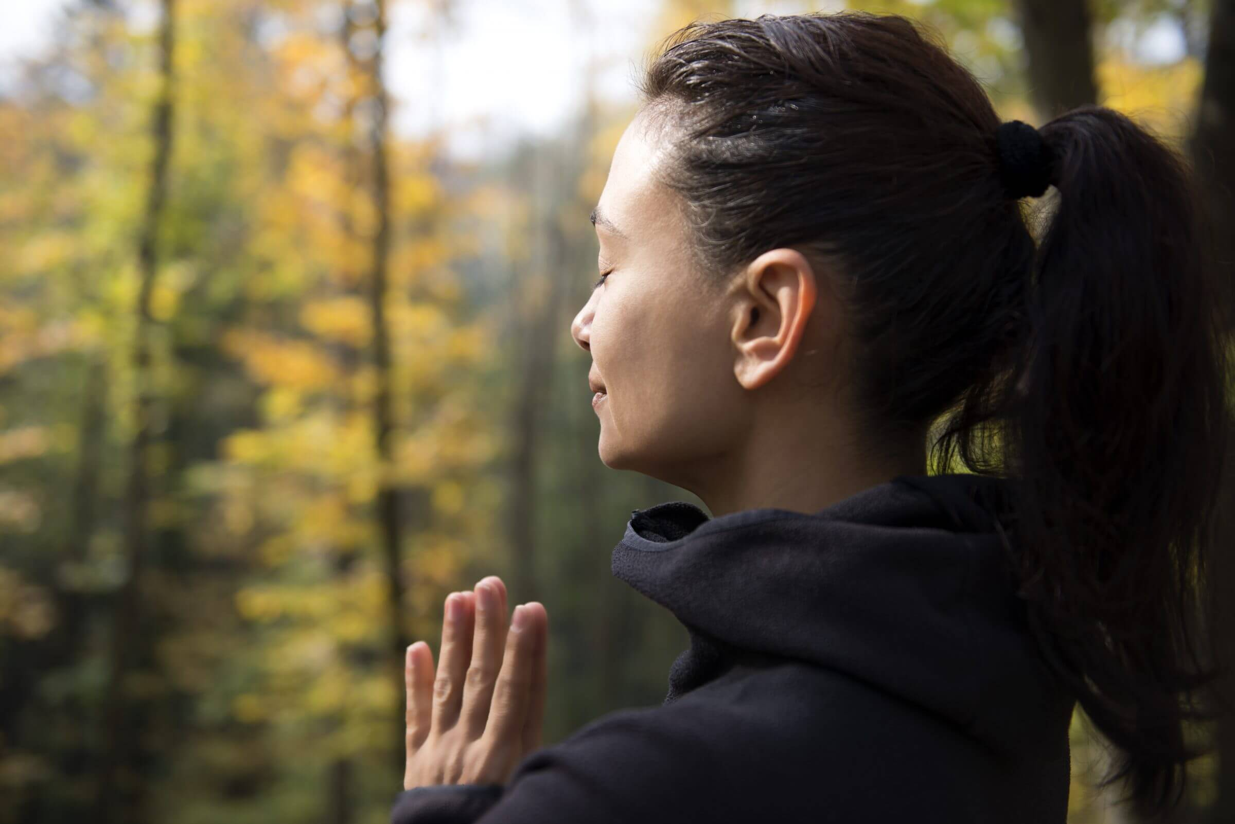 Practicing mindfulness in the forest near Mountain Waters